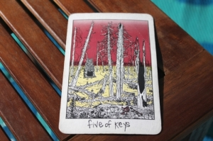 Collective Tarot - Five of Keys - A forest, after the fire has passed through.