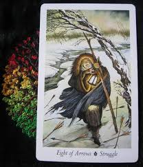 Eight of Arrows (Wildwood Tarot) - Struggle - A hooded figure carrying a lantern struggles through the snow in a fierce wind.
