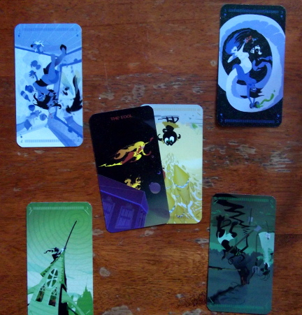Tarot of the Silicon Dawn:  Top Left - 7 of Water.  Top Right - 3 of Water.  Bottom Left - 3 of Earth.  Bottom Right - 5 of Earth.  Center - The Fool v.N. + 99 of Air
