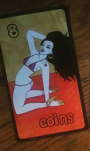 The Slutist Tarot - Eight of Coins - A white person in a string bikini, gold high heels, and gold jewelry, runs ter hand through her flowing black hair while doing a back-bend from her knees on a red floor.