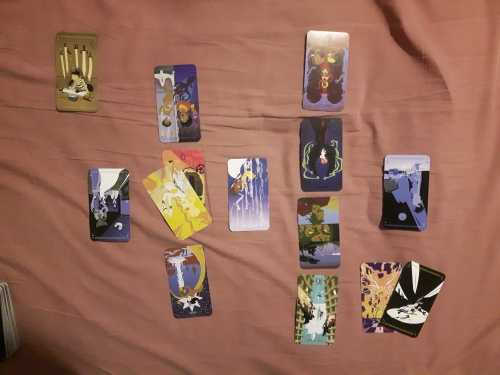 A grand cross spread using the Tarot of the Silicon Dawn, with four bonus cards